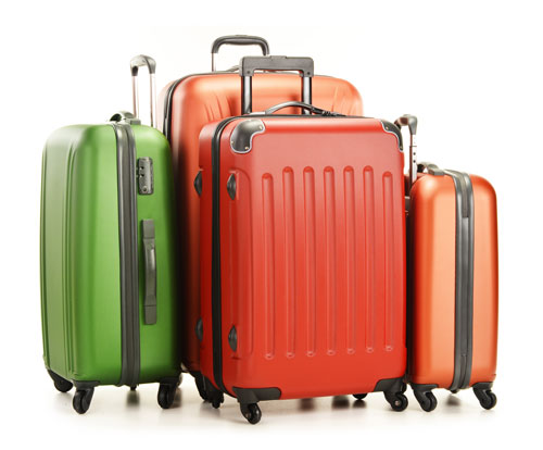 Suitcases representing Roberts-McClure travel insurance